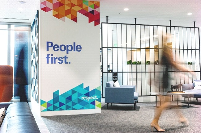 People culture - Image of our office with a people first slogan written on the wall